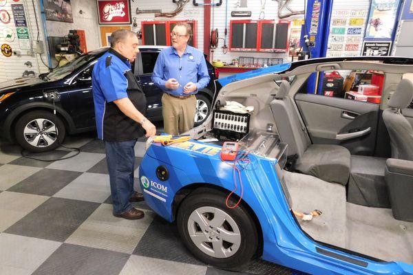 two men look at a car
