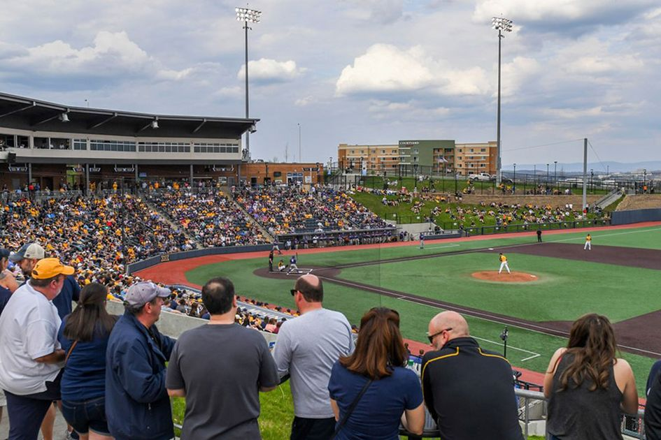 Crowded stands at WVU baseball game.
