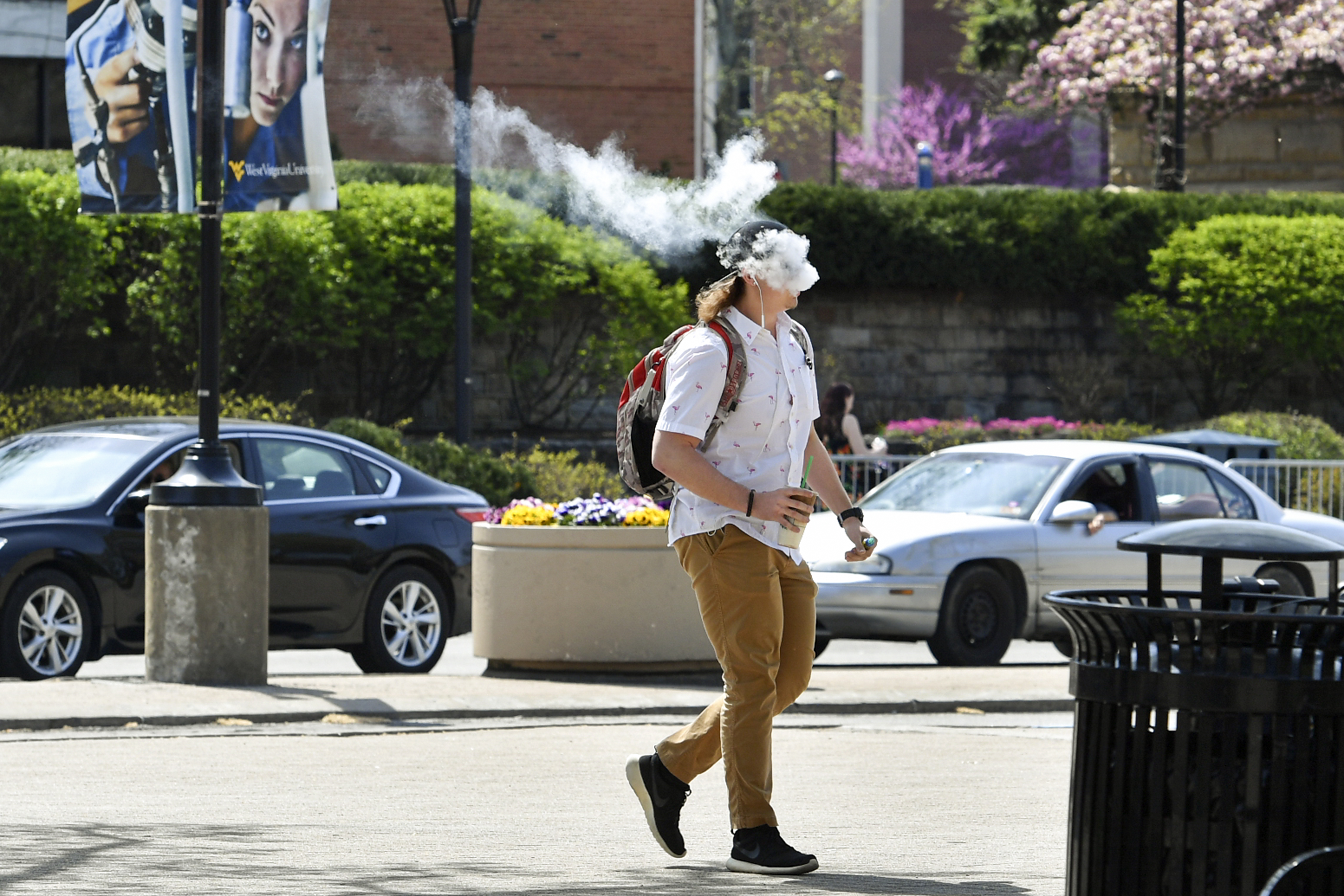 man vaping on college campus