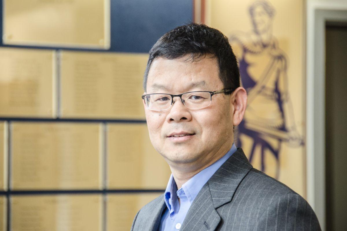 man in glasses, suit, tie