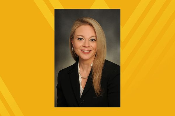 Traci LeMasters portrait on gold background