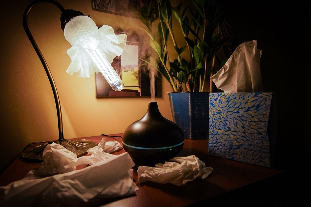photo of diffuser in low light, box of tissues