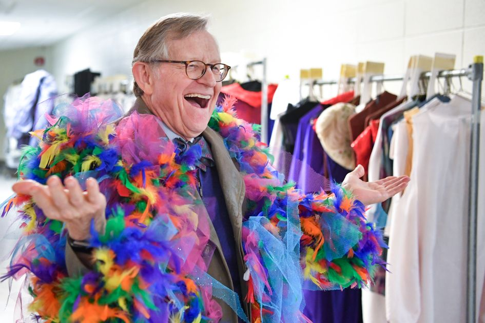 President E. Gordon Gee wearing a scarf made of colorful feathers.