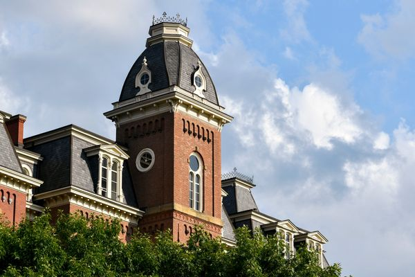 large brick building with cupola