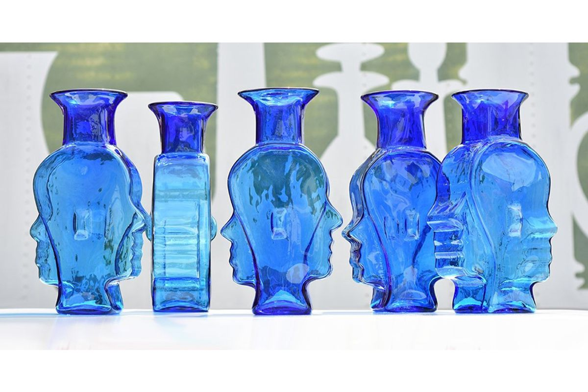 row of blue glass vases with odd shapes, curves