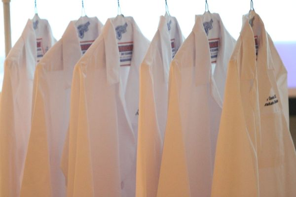white coats on hangers.