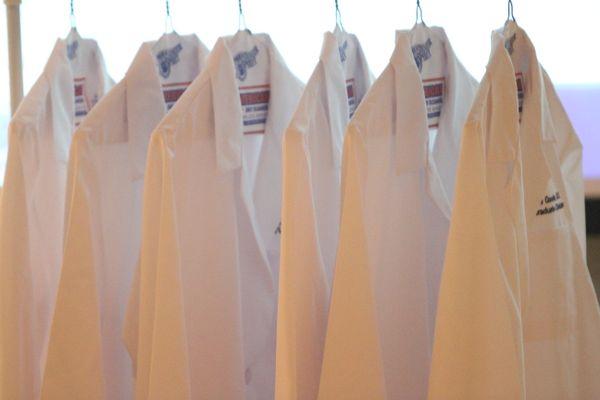 white coats on hangers.