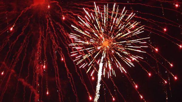Red fireworks in a dark sky.