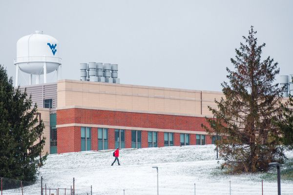 Student walks along snowy path on WVU's Evansdale Campus.