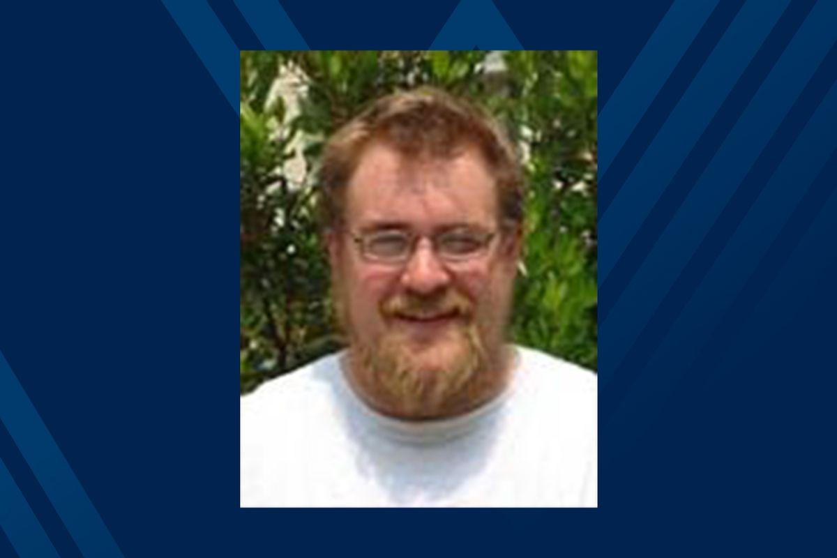 Photo of Graham Andrews on blue background