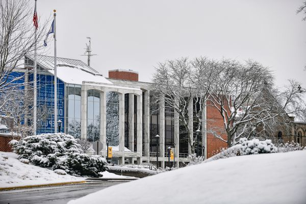 snowy scene on college campus with road