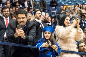 Amjad Khavabah, daughter Ghazal and friends make pictures and share the excitement of commencement, Amjad's wife graduated with a degree in Industrial Management December 15, 2017.