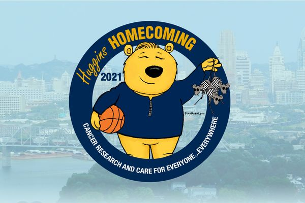 Cartoon bear holding a basketball and wearing a pullover.