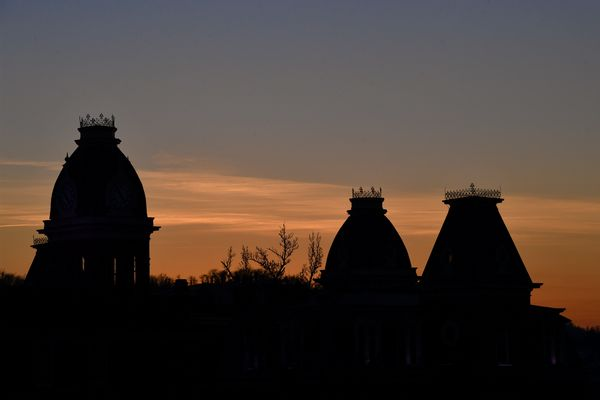 silhouettes of turrets in the sunset