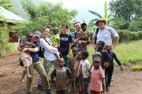WVUEWB members visited with locals while volunteering in the village of Kabughabugha.