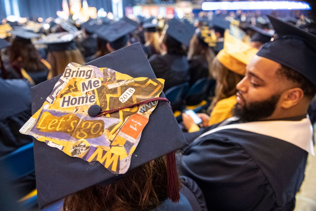 Staff, students and faculty celebrate December Commencement in the Coliseum Dec. 15, 2018.