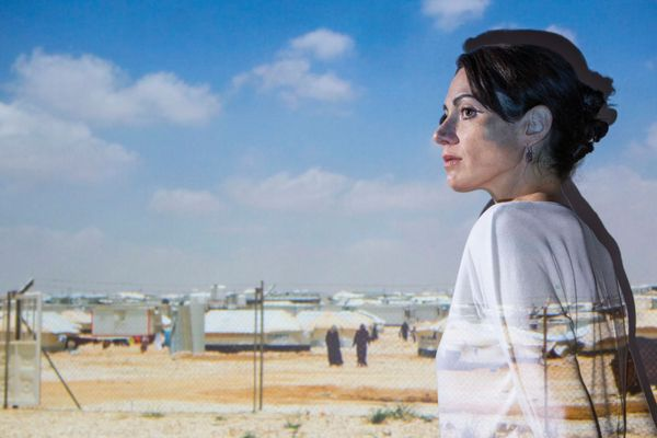 photo illustration of woman superimposed over photo of refugee camp