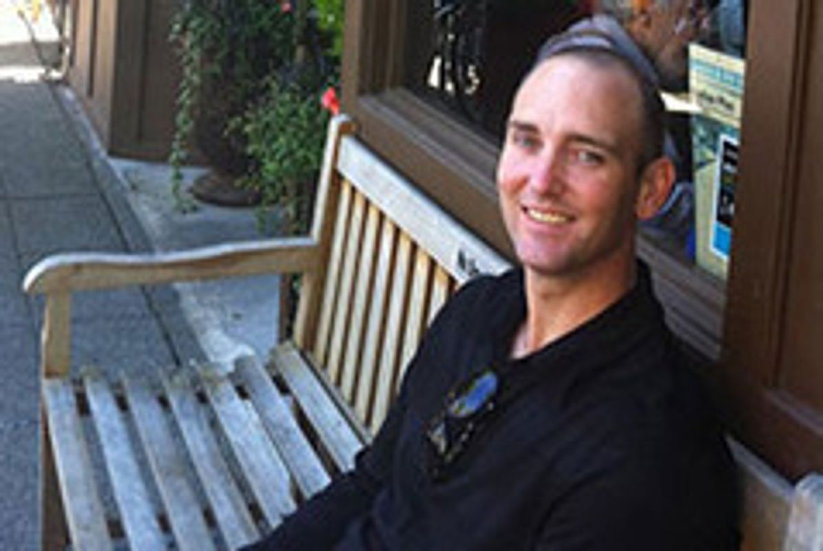 picture of Jason MacDonald sitting outdoors on a bench