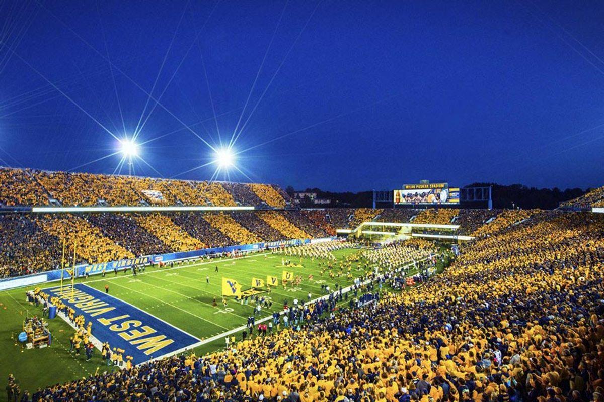 football stadium with crowd, night game