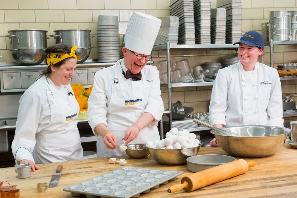President Gordon Gee dressed as a chef cracking eggs.