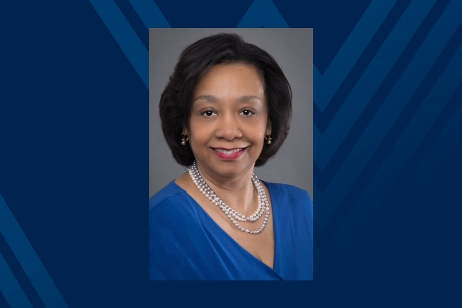 Photo of Sheila Price on blue background