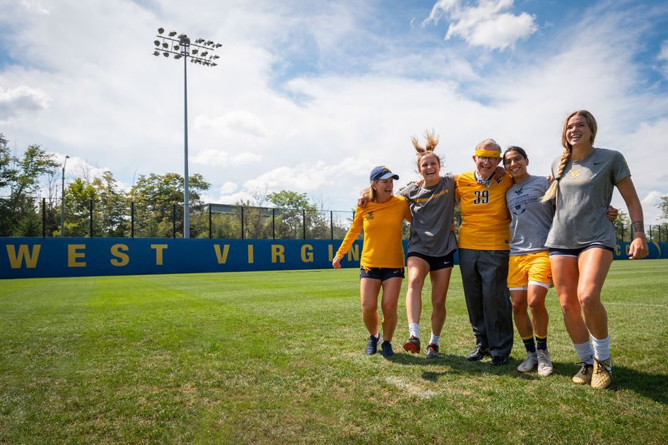 Gordon Gee with some members of the women's soccer team.