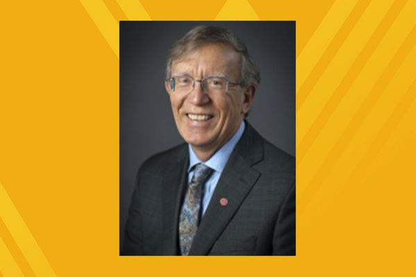 Portrait of Dr. Michael Hoffman on gold background