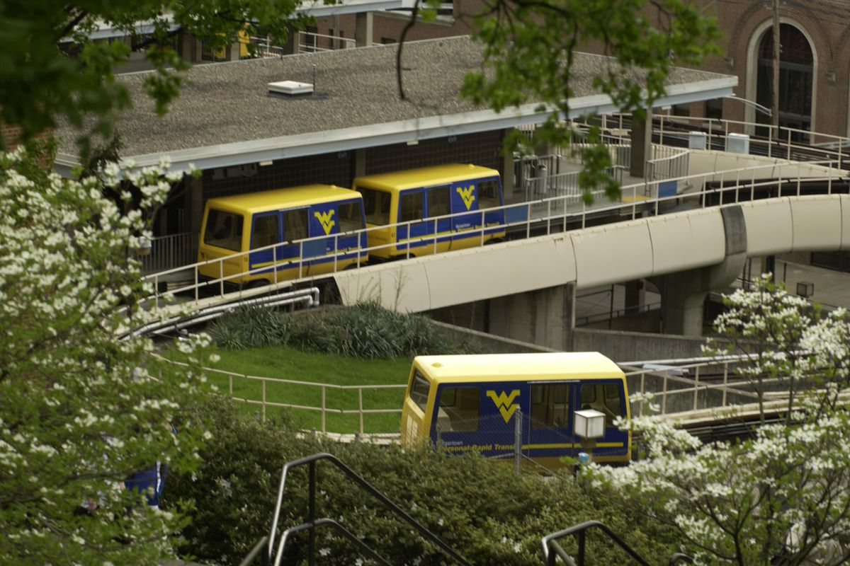 PRT cars in spring with blooming trees