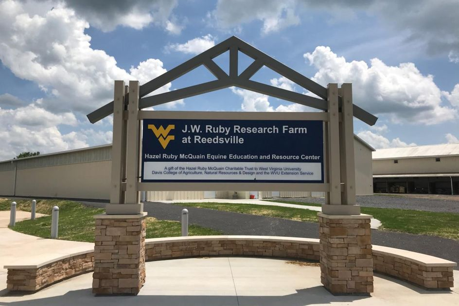 Sign that says J.W. Ruby Research Farm at Reedsville, Hazel Ruby McQuain Equine Education and Resource Center. A gift of the Hazel Ruby McQuain Charitable Trust to West Virginia University Davis College of Agriculture, Natural Resources & Design and the  WVU Extension Service.