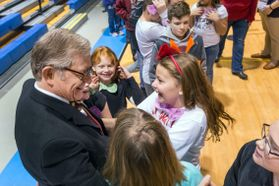WVU President Gordon Gee with students at Mylan Park Elementary during Hour of Code.