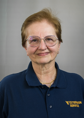 Woman posed smiling with glasses on