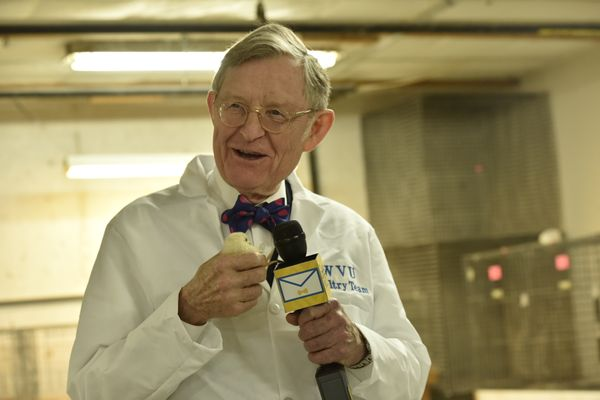 President Gordon Gee holding a baby chick.