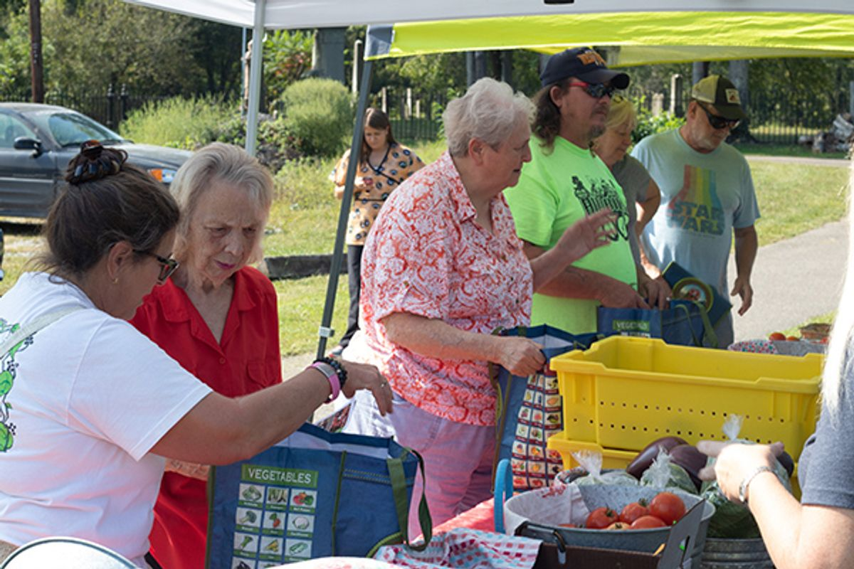 elderly West Virginians shop at pop up produce stand