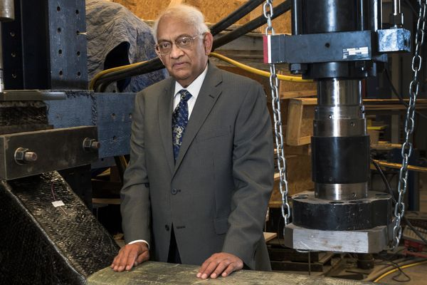 Hota GangaRao stands with the product of his research that reinforces existing infrastructure