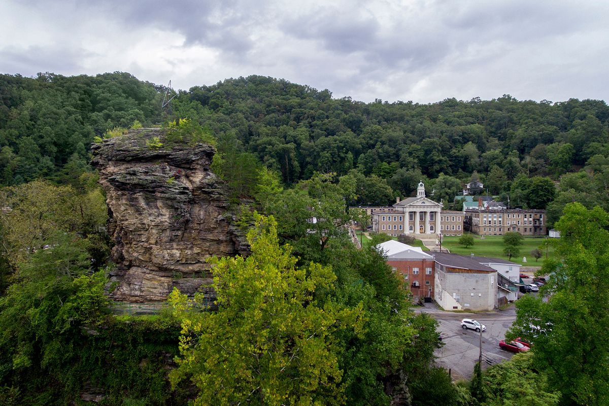 a large rock formation outside a town, focusing on a courthouse