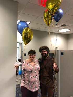 WVU Mountaineer with woman holding balloons