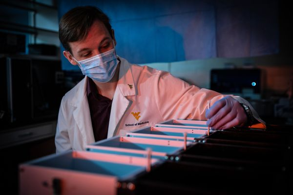 man in medical mask in lab