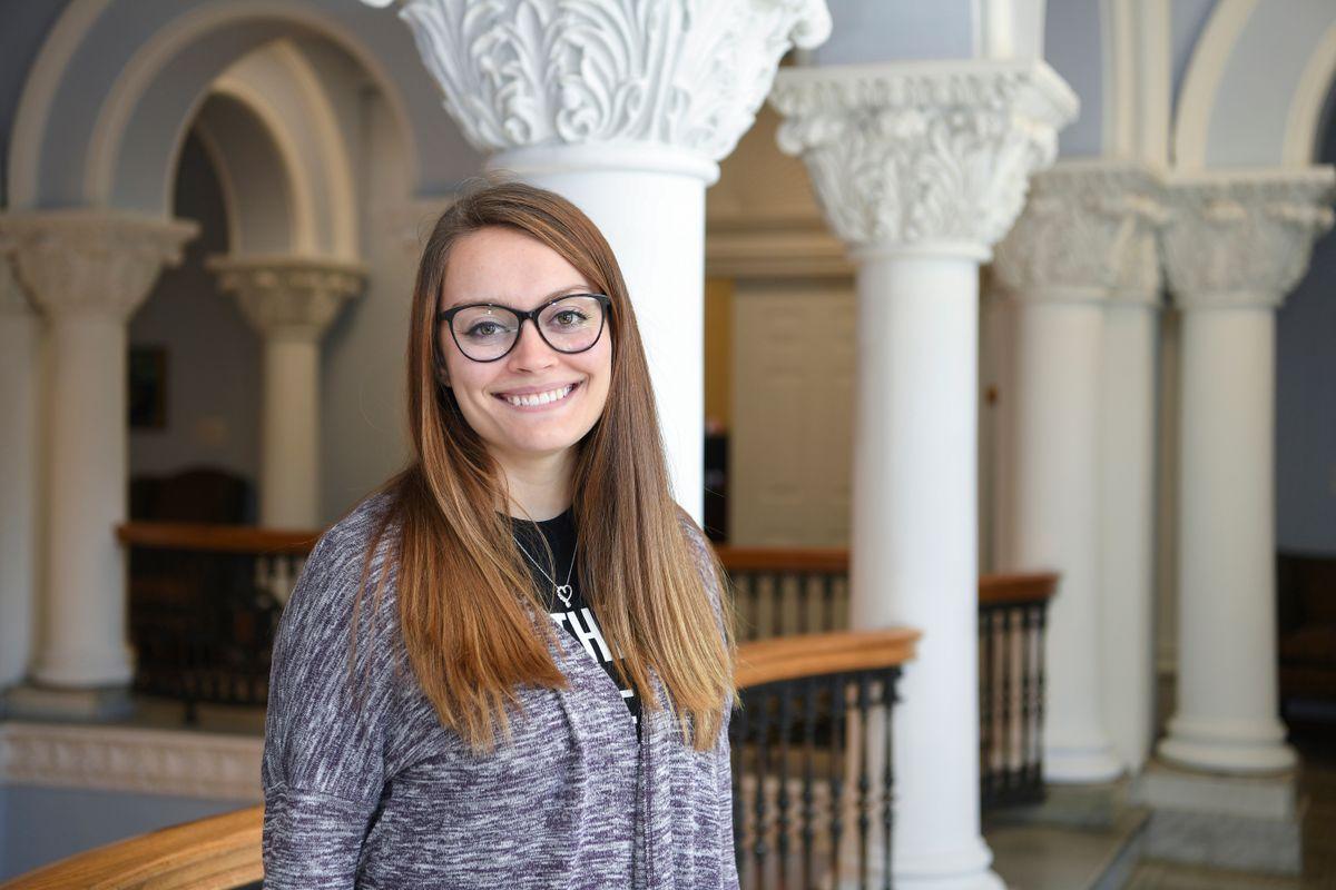 Emma Harrison stands in Stewart Hall