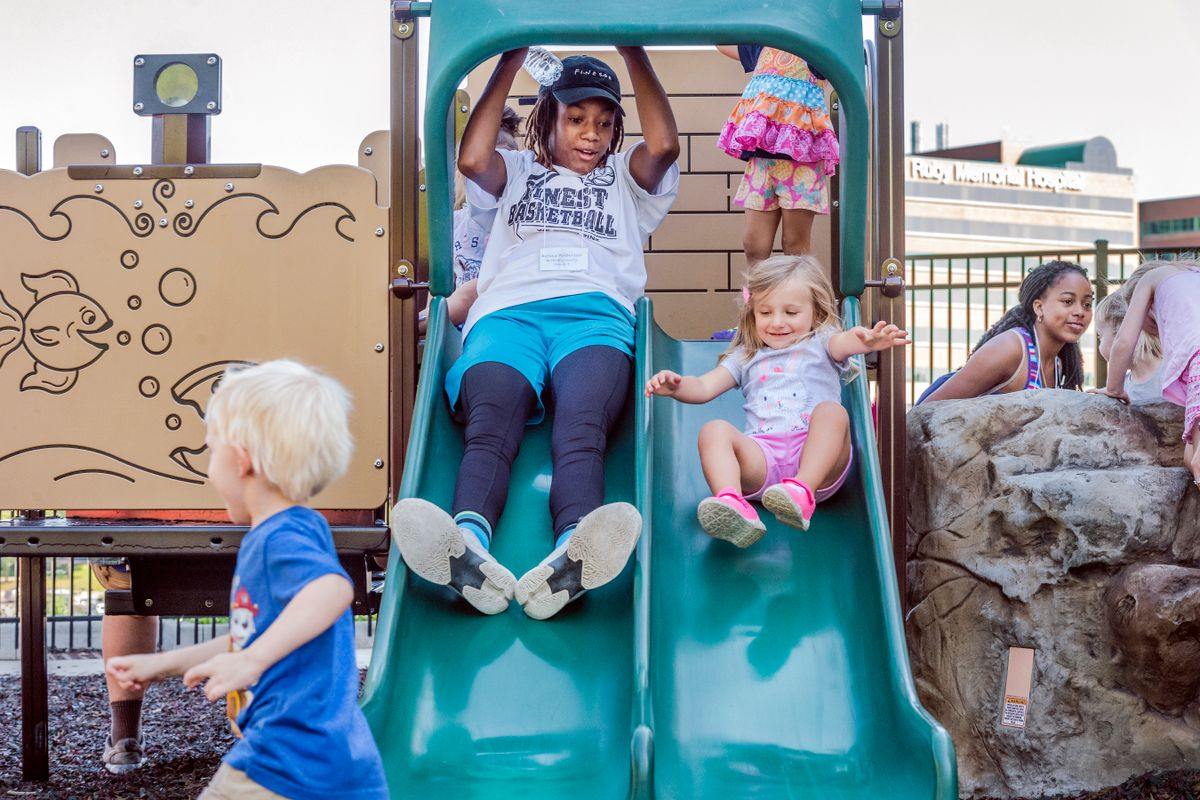 young woman, children on slide