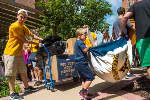 Students of all ages help during Honors College move-in day for the start of the 2016-17 school year.