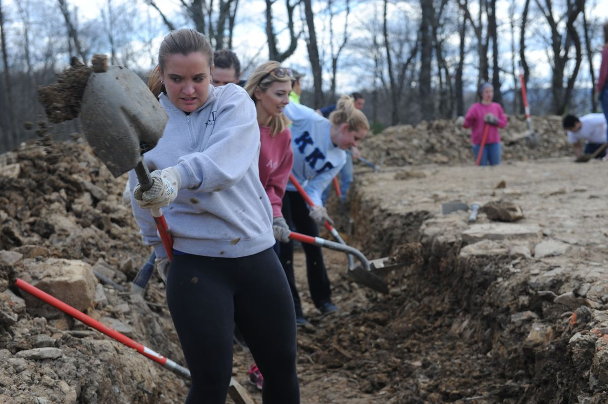 Sorority members digging on a Big Greek Day of Service project