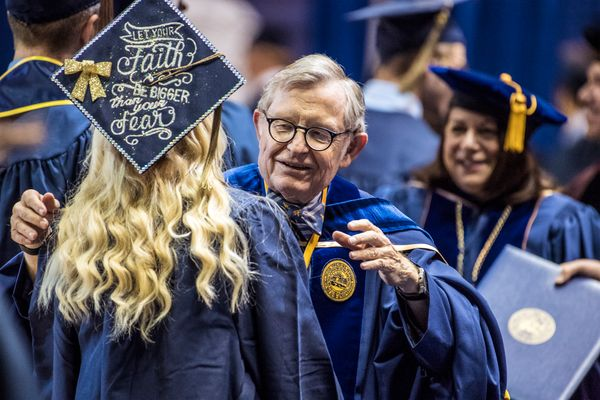WVU President Gordon Gee greets students on stage during commencement ceremonies Dec. 15, 2017.