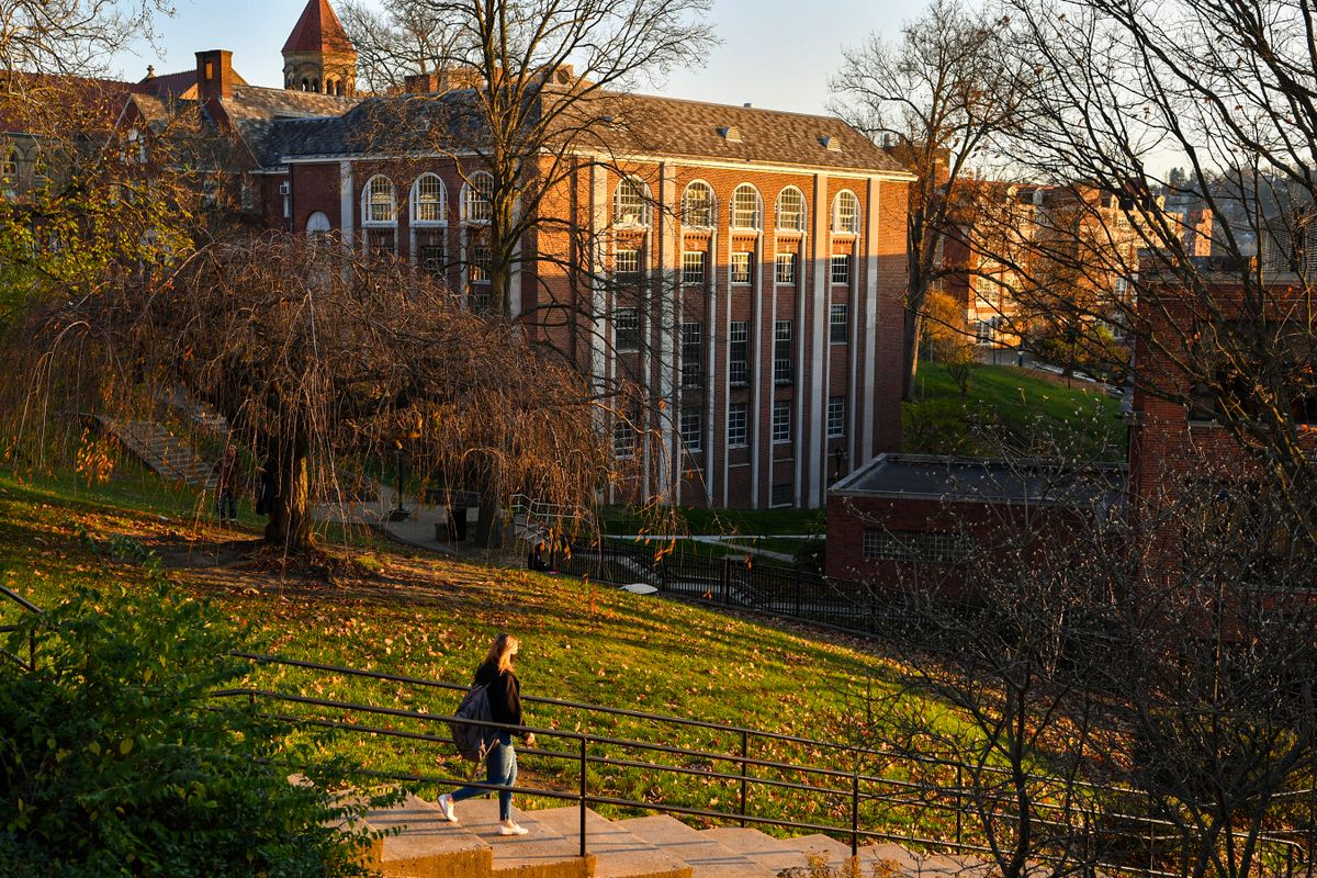 student walking on college campus