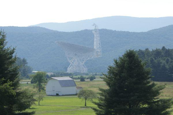 A large satellite telescope in a field