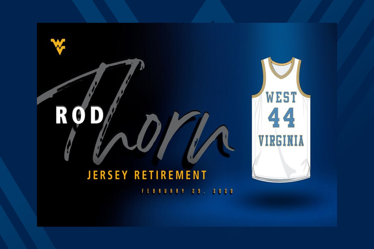 white writing on blue background with white basketball jersey