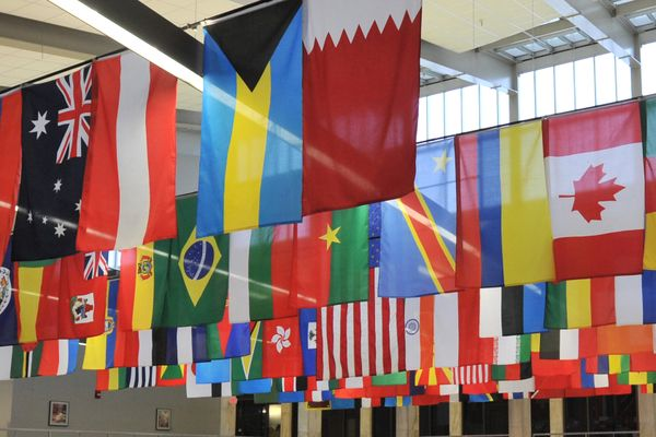 various flags hanging from a ceiling