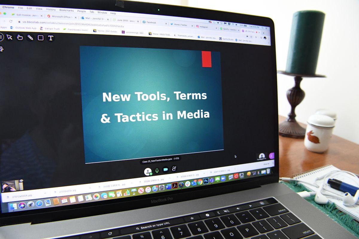 photo of computer displaying a presentation