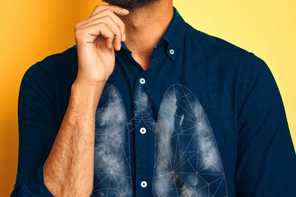 illustration of lung cancer against a close up of man's chest