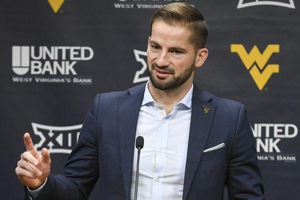 good looking man stands at podium