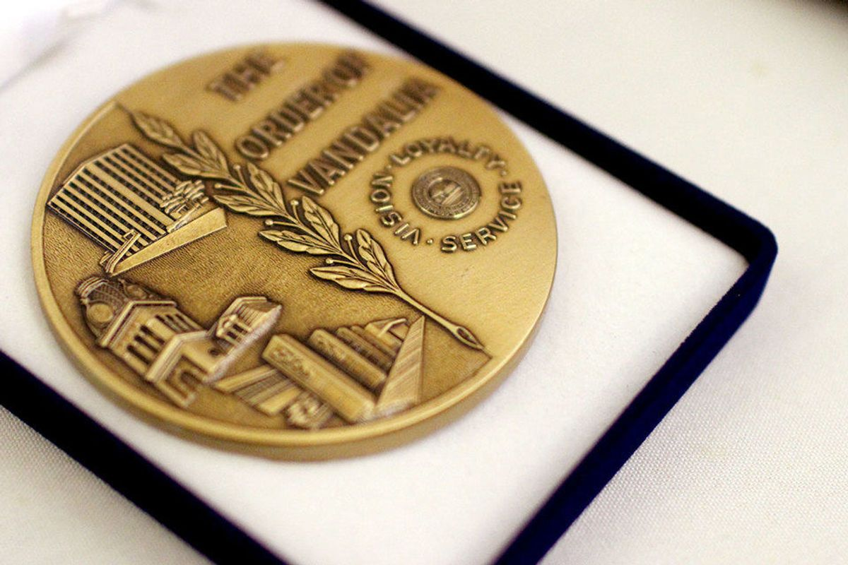 photo of a gold medallion in a box